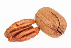 Few pecan nuts, one cracked Royalty Free Stock Photography