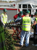 Few people helping transport injured person. First respond team of people is working on help one injured man to transport him into the hospital. this is the Stock Images