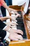 Few people playing piano. Together royalty free stock photo