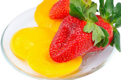 Few piece peaches lie on plate Royalty Free Stock Photos