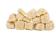 Few pieces of brown sugar Stock Photos