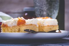 Few pieces of cake with cream topping with pieces of tangerines royalty free stock photo