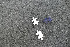 Few pieces of paper puzzle on a floor Stock Photography