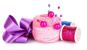 Few pins in wool ball Royalty Free Stock Images