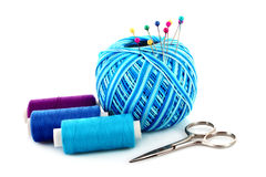 Few pins in wool ball isolated Royalty Free Stock Photo