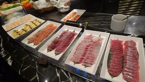 Few plates of raw fish on display table royalty free stock photo