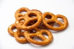 Few pretzels on a white background Stock Photo