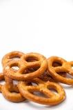 Few pretzels on a white background Stock Photos
