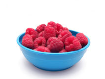 Few raspberries in bowl Stock Photo
