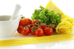 Few raw ingredients for making pasta. Over white background Royalty Free Stock Images