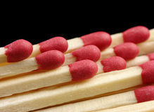 Few red matchsticks on black background Stock Images