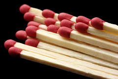 Few red matchsticks on black background Royalty Free Stock Photos