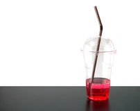 Few red sweet drink with straw in transparent plastic cup Royalty Free Stock Photos