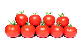Few red tomatoes isolated Royalty Free Stock Photography