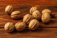 A few ripe walnuts on an old wooden background Stock Photo
