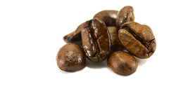 A few roasted coffee beans. A few Dark Roasted Coffee Beans isolated on white Stock Images