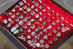 Few rows of souvenir large rings on red Royalty Free Stock Photo