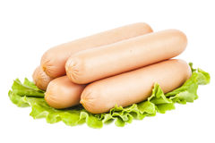 Few sausage on the leaf of lettuce Stock Image