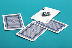 A few scattered playing cards on a green Royalty Free Stock Images