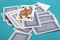 A few scattered playing cards on a green Royalty Free Stock Photography