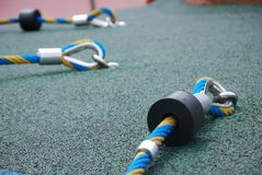 A few secure loops for climbing ropes. A photo taken on a few secure loops section of some climbing ropes at an open playground Stock Photography
