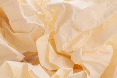 A few sheets of crumpled paper in a yellowish color. A few sheets of crumpled paper in a yellowish sheet of clean paper closeup Stock Photos