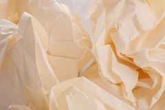A few sheets of crumpled paper in a yellowish color. A few sheets of crumpled paper in a yellowish sheet of clean paper closeup Stock Images
