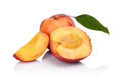 Few sliced nectarines with leaf isolated on white Royalty Free Stock Image