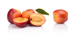 Few sliced nectarines with leaf  on white Royalty Free Stock Photography