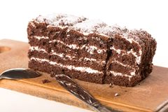 Few slices of chocolate cake on wooden desk stock photography