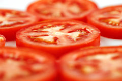 A few slices of organic vine tomatoes shot Royalty Free Stock Image