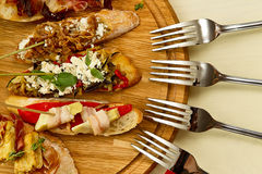 Few spanish tapas. Are laid on a wooden board Royalty Free Stock Photography