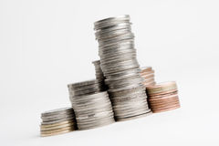 A few stacks of coins isolated Royalty Free Stock Photos