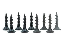 Few standing metal and wood screws. Isolated on the white background stock images