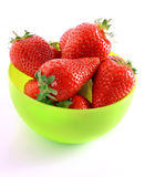 Few strawberries in green cup isolated Royalty Free Stock Image