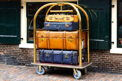 A few suitcases on a trolley. Stock Images