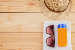 Few summer items on wooden background. Stock Image