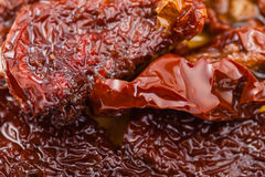 Few sun-dried red tomatoes in olive oil Royalty Free Stock Photography