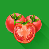 Few tomatoes on green Royalty Free Stock Images