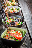 Few traditional asian noodles with seafood Royalty Free Stock Photo