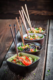 Few traditional asian noodles with vegetables Stock Images