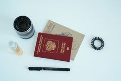 Flat Lay Of Few Travel Items. Few travel items passport, pen, note, etc.  captured from above on white background Royalty Free Stock Photography