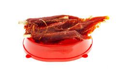 Few treats for dogs in red bowl  on white background Royalty Free Stock Photography