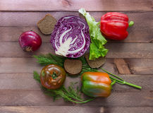 Few vegetables in the center of the wooden table Stock Image