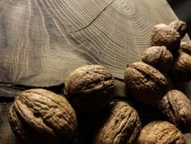 Few walnuts on wooden table royalty free stock image