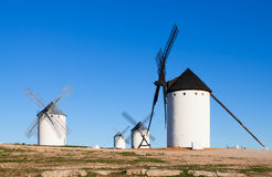 Few windmills in field Royalty Free Stock Photos