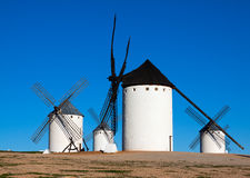 Few windmills in field Royalty Free Stock Photo
