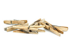Few wooden clothespins. Few wooden clotespins isolated on the white background royalty free stock photos