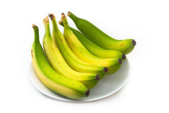 A few yellow bananas on a white plate Stock Photography