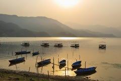 Fewa lake at sunset in Pokhara Royalty Free Stock Images